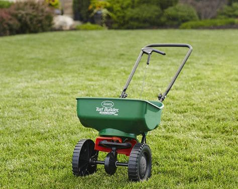 Scotts Turf Builder EdgeGuard Mini Broadcast Spreader - Spreads Grass Seed, Fertilizer and Ice Melt